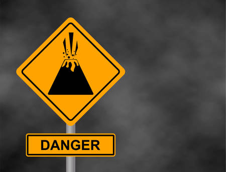 Background of dark grey sky with cumulus clouds and yellow road sign with text Danger Volcano.