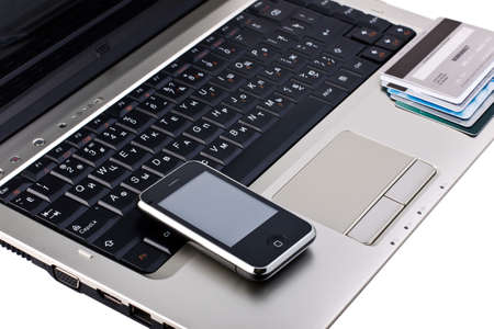 mobile phone with credit cards on laptop Editorial