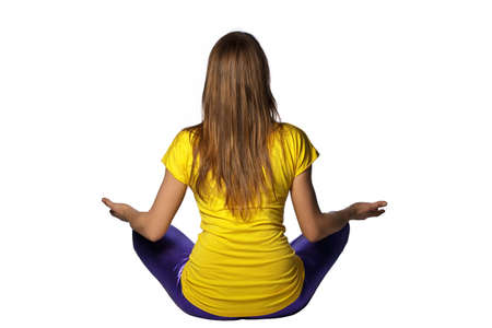 spirtual: young woman in yellow t-shirt shows meditation