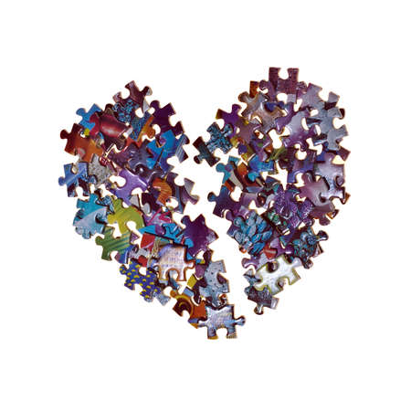 broken heart made from the puzzle , isolated photo