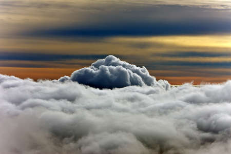 cloudscape: view of the clouds with the peak of Mount Stock Photo