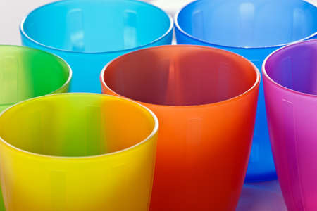 colored plastic cups, close-up Фото со стока