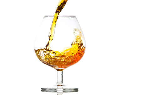 filling a glass of brandy, close-up Stock Photo