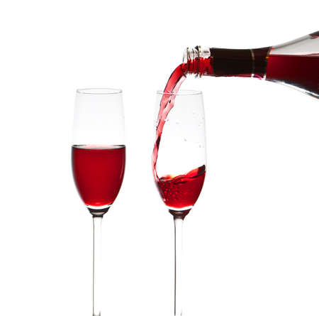 Pouring a glass of wine, close-up photo