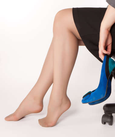 women is sitting on the chair with blue shoes in her arms Stock Photo - 11030166