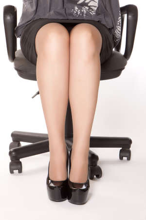 photo of woman in black shoes sitting in chair photo