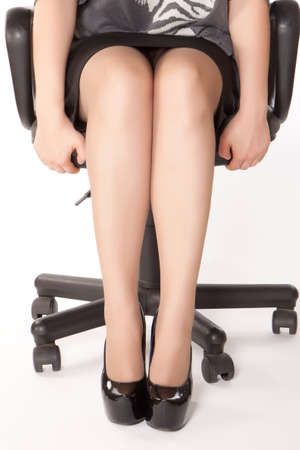 secretary skirt: stressful woman sitting in office chair