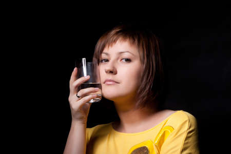 young woman with glass water, black background Stock Photo - 11105858