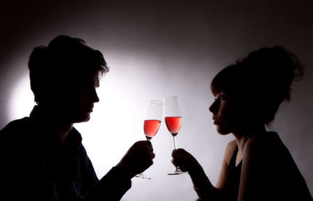 photo of young couple drinking rose wine photo