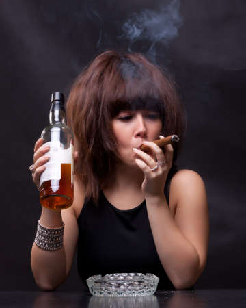 photo of woman drinks alcohol and smokes a cigar Stock Photo - 11141573