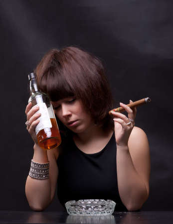 liquor girl: photo of woman drinks alcohol and smokes a cigar