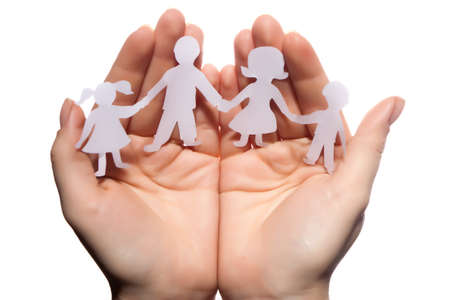 Paper chain family protected in cupped hands on white background Stock Photo