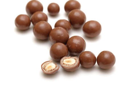 chocolate balls with nuts on a white background photo