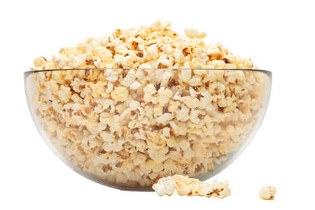popcorn in glass bowl over white background photo