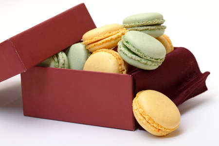 Colorful Macaron in paper box on white background photo
