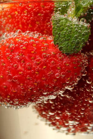Glasses of sparkling wine and strawberry, macro photo