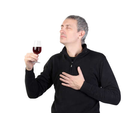 Man holding a glass of red port wine, on white background Фото со стока