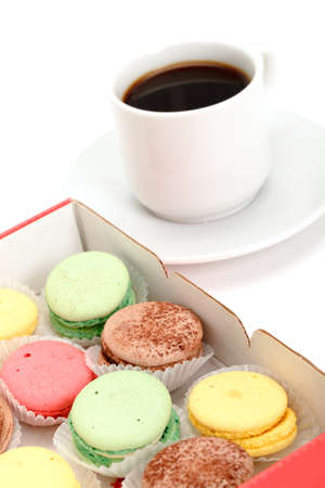 Colorful Macaroon and cup of coffee on white background photo