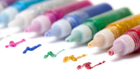 Set Colorful sparkle glue pens on white background