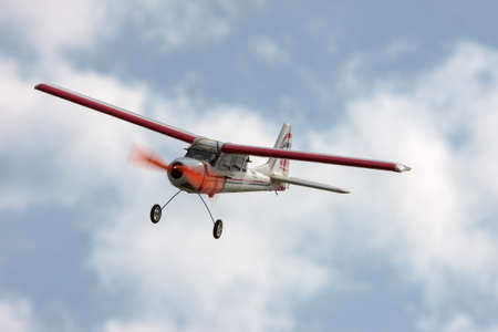 RC model airplane flying in the blue sky, closeup photo