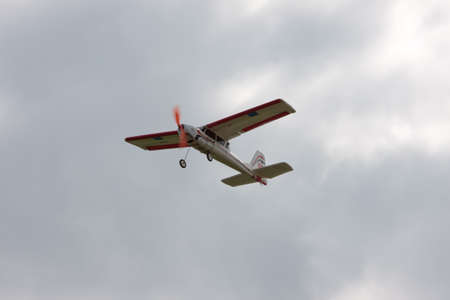 RC model airplane flying in the sky, closeup photo