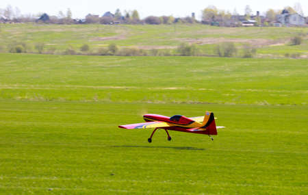 RC model airplane lands on the grass field photo