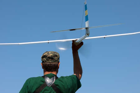 Man launches into the sky RC glider, closeup photo