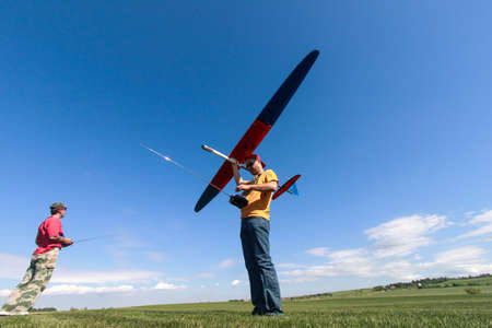Man launches into the sky RC glider, wide-angle photo