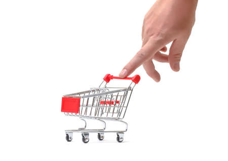 Shopping Cart with Hand on white background photo