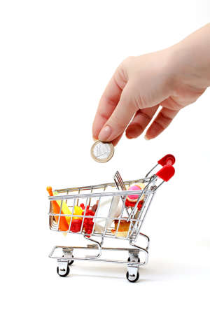 Shopping Cart with Hand and Coin on white background photo