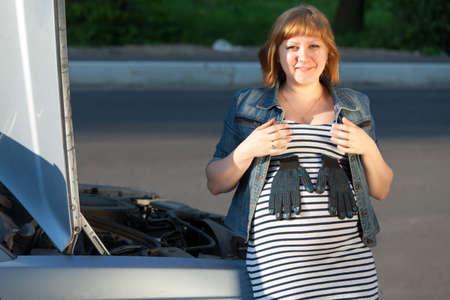 Pregnant Woman Near the Broken Car Stock Photo - 13797987
