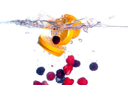 Fresh Fruit Falls under Water with a Splash, isolated photo