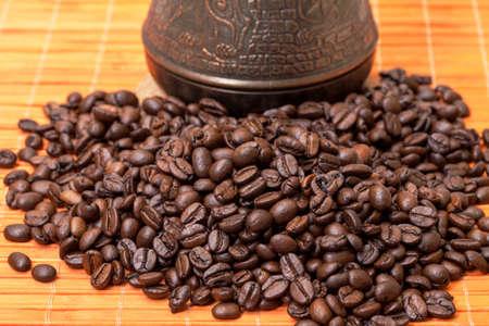 cezve: Cezve and Coffee Beans on Bamboo Mat, closeup