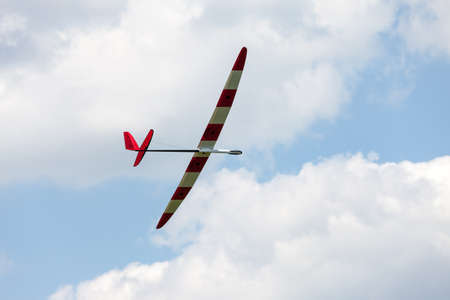 RC glider flying in the blue sky, closeup photo