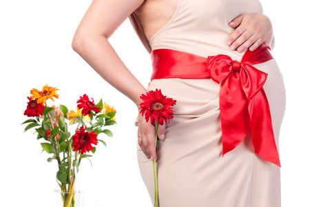 Pregnant Woman with Flowers, over white background photo