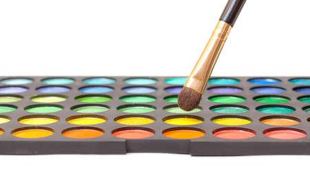 Set of Multicolored Eyeshadows with Brush, closeup photo