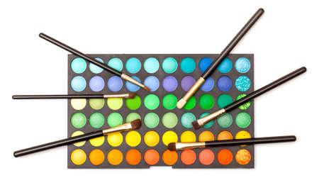 Set of Multicolored Eyeshadows with Brushes, closeup photo