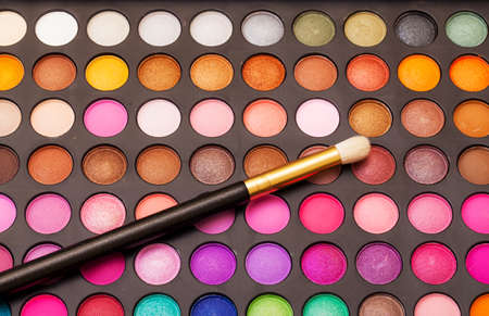 Set of Multicolored Eyeshadows with Brush, closeup photo