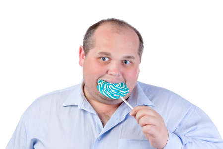 Fat Man in a Blue Shirt, Eating a Lollipop, isolated photo