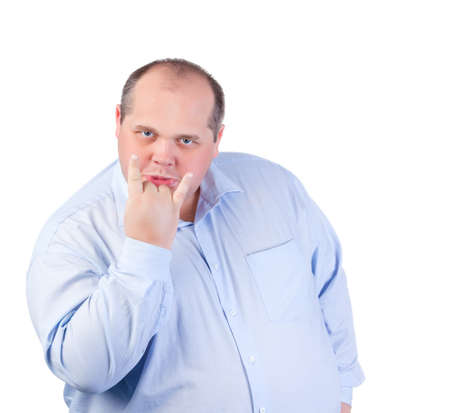 fatso: Fat Man in a Blue Shirt, Showing Obscene Gestures, isolated Stock Photo