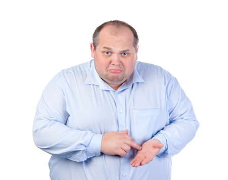 Unhappy Fat Man in a Blue Shirt, isolated photo