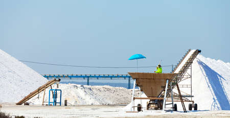 Extraction of salt  Salt mountains on blue sky