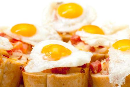 quail egg: Baguette Slice with Ham and Fried Quail Egg, closeup Stock Photo