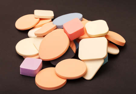 Variety Cosmetic Sponges on dark background