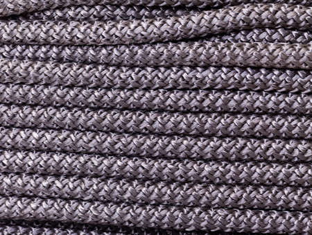 braided flexible: Abstract background of braided interwoven dark cord