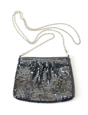 vanity bag: Classic black handbag with a silver chain strap on a white studio background