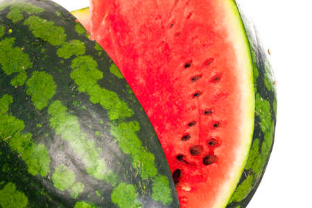 pips: Sliced ripe fresh watermelon showing the refreshing watery sweet pink pulp and pips isolated on a white background
