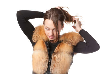 Stylish relaxed young woman in winter fur jacket isolated on white Stock Photo - 15834692