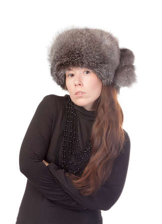 vivacious: Vivacious woman in a winter outfit with a fur hat on white background Stock Photo