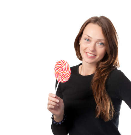 Studio shot of attractive smiling female with a lollipop isolated on white photo